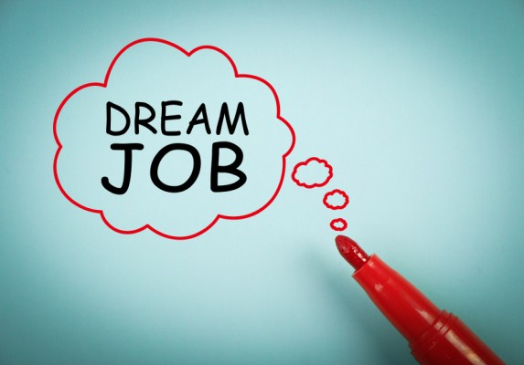 Dream Job concept is on blue paper with a red marker aside.